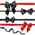 Black and red satin bows isolated on white.