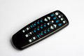 Black remote control tv on a white surface Stock Images