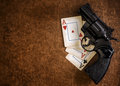 Black revolver and old playing cards Royalty Free Stock Images