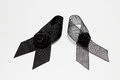 Black ribbon; decoration black ribbon hand made artistic design for sadness expression isolated on white background. Royalty Free Stock Photo