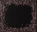 Black rice in frame on a dark stone background with water droplets Royalty Free Stock Photo