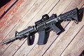 The black rifle ar assault carbine m a on a wooden surface shallow dof Stock Photos