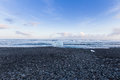 Black rock and sand beach coastline winter season landscape Royalty Free Stock Photo