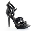 Black rock shoe women s high heel with studs Royalty Free Stock Photos