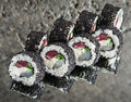 Black roll made with tuna, scallop, cucumber Royalty Free Stock Photo