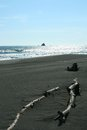 Black sand volcanic beach pacific ocean east coast of peninsula kamchatcka Stock Photos