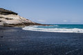 Black sand volcanic beach with the sea view in Tenerife, Canary islands Royalty Free Stock Photo