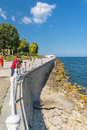 Black sea shore constanta romania tourists on the pedestrian aria near old casino enjoying the view of in Royalty Free Stock Photo