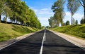 Black serpentine of asphalt road in sunny day. Stock Image