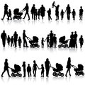 Black set of silhouettes of parents and children