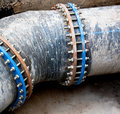 Black sewer pipe with bolt clamp Royalty Free Stock Photo