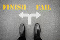 Black shoes standing at the crossroad - finish or fail Royalty Free Stock Photo