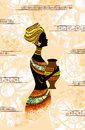 Black silhouette of a woman in profile with a jug in his hands on a light background the ethnic african clothing hand yellow Stock Photo