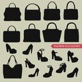 Black silhouettes of  fashion women's handbag,high-heeled shoes Royalty Free Stock Photo