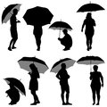 Black silhouettes man and woman under umbrella vector illustrations Royalty Free Stock Image