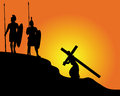 Black silhouettes of soldiers carrying the cross and on an orange background Royalty Free Stock Photography