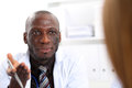 Black skinned male doctor communicate with patient