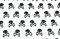 Black skulls on a white background Stock Photography