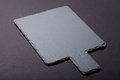 Black slate cutting board on black background. Selective focus Royalty Free Stock Photo
