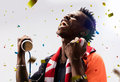 Black Soccer fan in action emotions confetti Royalty Free Stock Photo