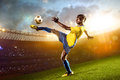 Black soccer player in action stadium field evening Royalty Free Stock Images