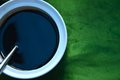 Black soy sauce on a white cup Stock Image