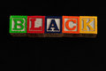 Black spelled with colorful blocks Royalty Free Stock Photo