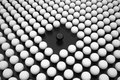 Black Sphere between Array of White Spheres Royalty Free Stock Images