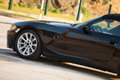 Black sport car transportation automobiles side view of Royalty Free Stock Photos