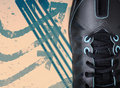 Black sport shoe on grunge background Royalty Free Stock Photos