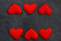 Black stone background with frames of red hearts closeup Stock Photo