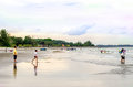 Black stone beach kuantan pahang june nice view of people playing and swimming near the beach located at Stock Photos