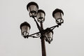 Black streetlight with five lamps Royalty Free Stock Photo
