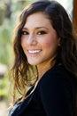 Black sukni uśmiechnięta piękną kobietą Fotografia Stock