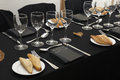 Black tablecloth with glasses and dishes piece of bread Stock Photo