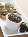 Black Tapenade on Toasts Royalty Free Stock Photos