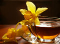 Black tea and flowers narcissuses Royalty Free Stock Photography