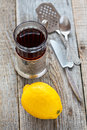 Black tea in glass and lemon. Royalty Free Stock Photo