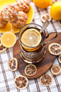 Black tea with lemon in the silver glass holder dry around Royalty Free Stock Photography