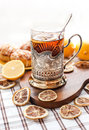 Black tea with lemon in the silver glass holder dry around Royalty Free Stock Images
