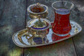Black tea in a traditional Turkish cup on a silver platter Royalty Free Stock Photo