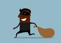Black thief running with sack of loot joyful african american in mask away from the pursuit dragging suited for criminal or theft Stock Photo