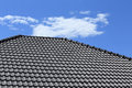Black tiles roof on a new house Royalty Free Stock Photo