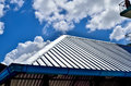 Black tiles roof on a new house with blue sky Royalty Free Stock Photo