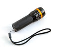 Black torchlight with strap on white background Royalty Free Stock Photo