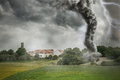Black tornado funnel and lightning over field Royalty Free Stock Photo