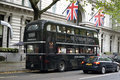 Black tour double decker classic routemaster bus in london the traditional routemaster has become a famous feature of london Royalty Free Stock Photo