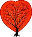 Black tree silhouette in the red shape of heart