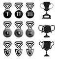 Black trophy and awards icons set vector Stock Photos