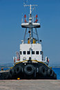 Black tugboat a is moored in the harbor Stock Image